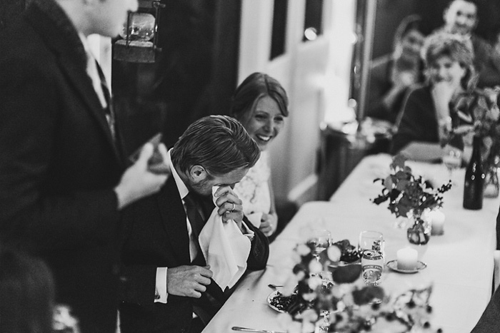 groom crying at reception