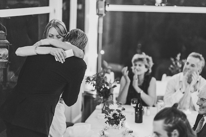 bride and groom hugging at reception