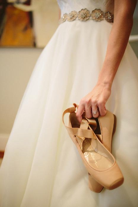 bride holding ballet flats