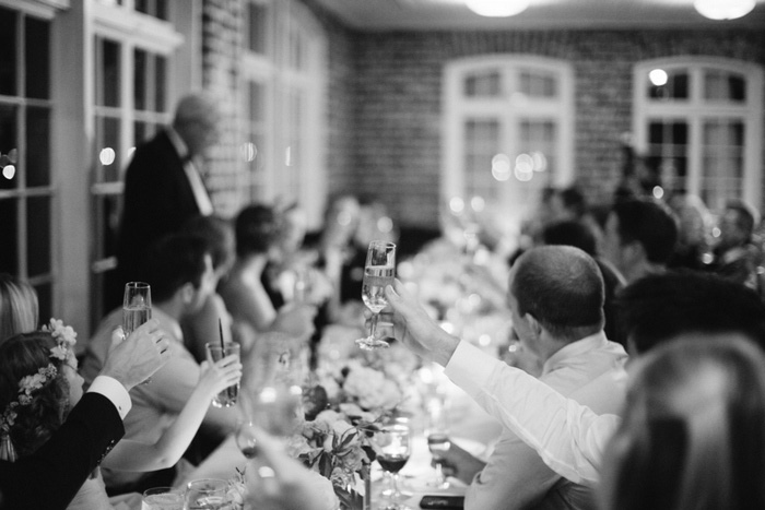 guests raising glasses