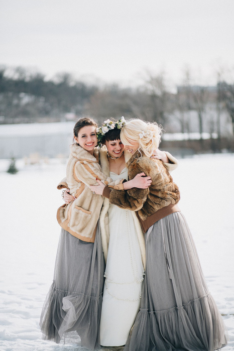 bride and bridesmaids in fur coats