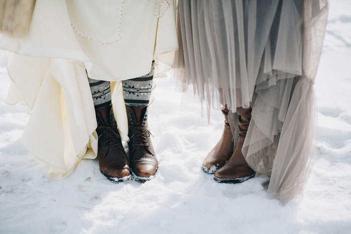 bride and bridesmaid in boots and socks