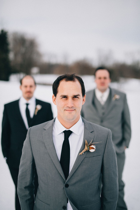 groom and groomsmen in the snow