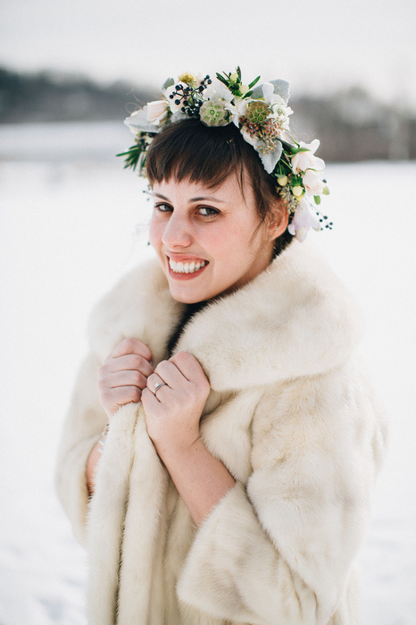 bride in flower crown and fur coat