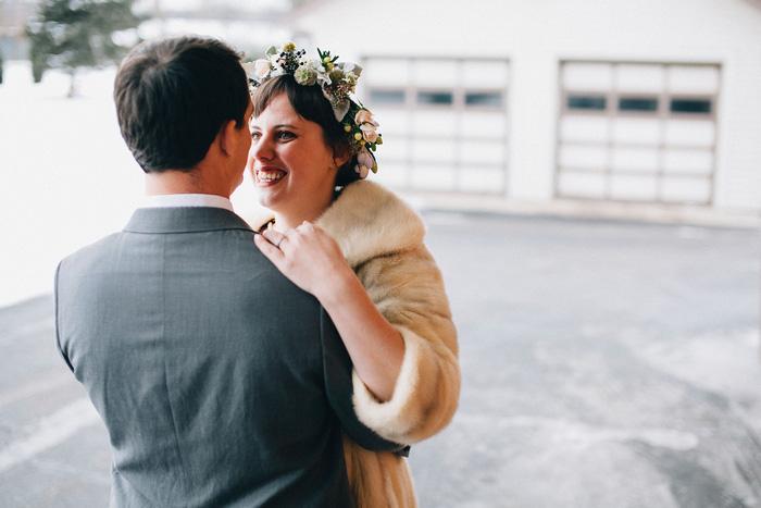 bride and groom huggin