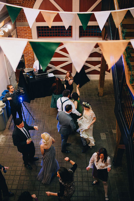 guests dancing at barn wedding