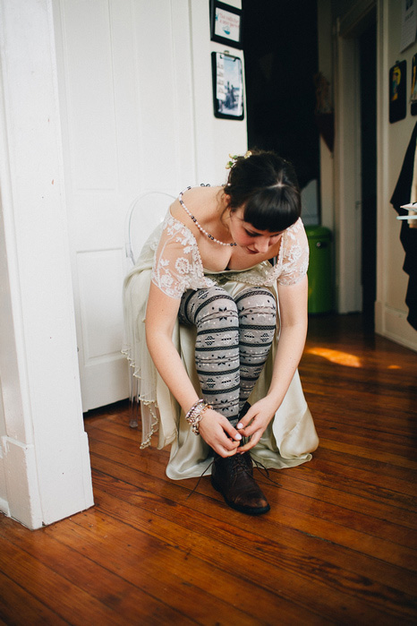 bride lacing up boots