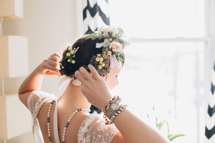bride putting on flower crown