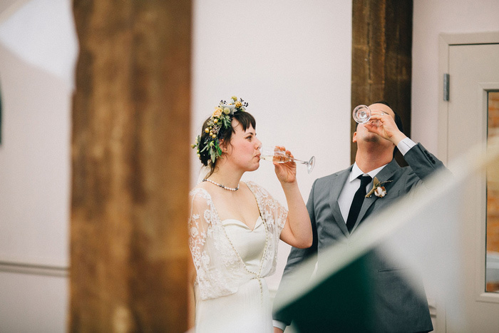 bride and groom drinking champagne