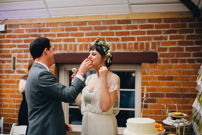 groom feeding bride cake