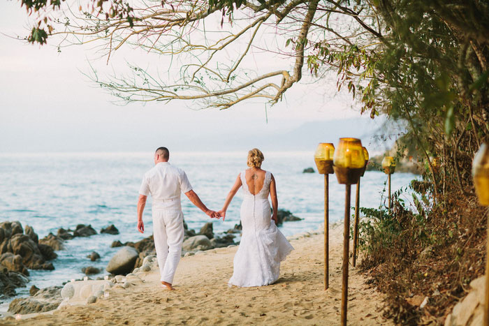 bride and groom waking on the beach