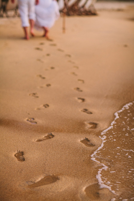 bride and groom footprints in the sand