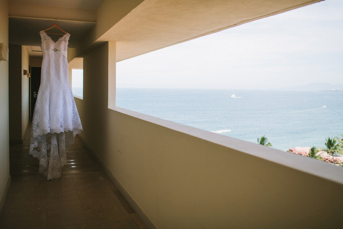 wedding dress hanging on resort balcony