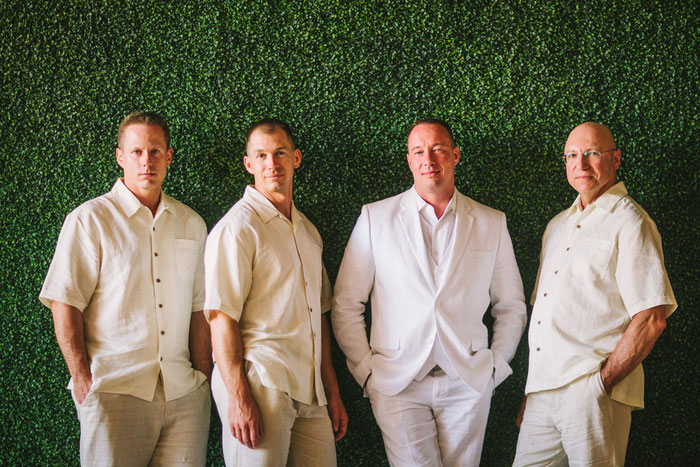 groomsmen in white