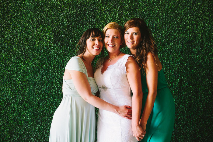 bride's with bridesmaids in green
