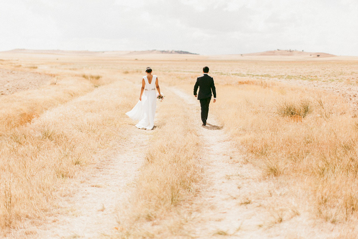 bride and groom walking in countryside