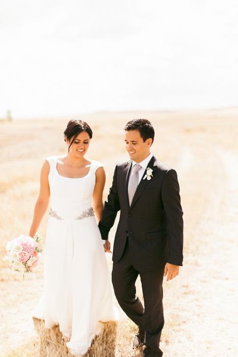 bride and groom walking in countryside