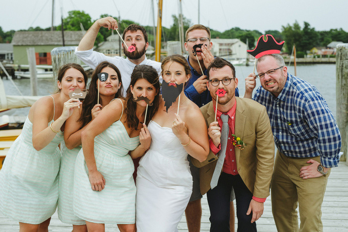 bridal party with photo booth props