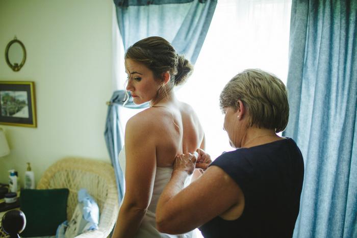 bride doing up her dress