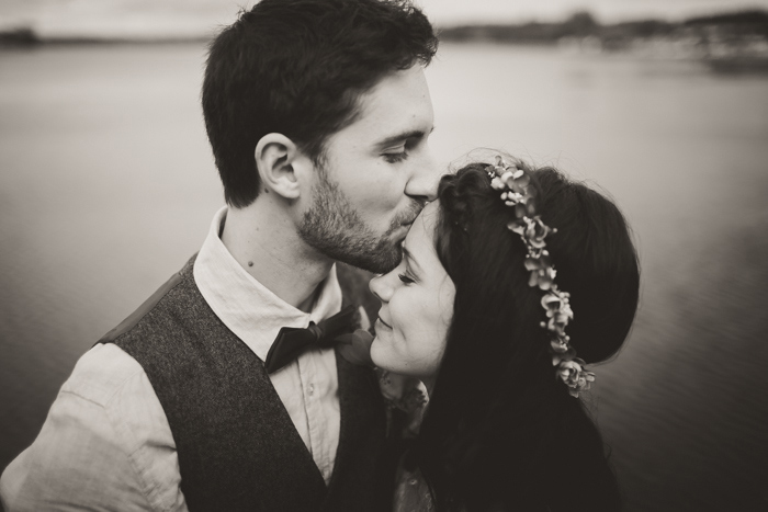 groom kissing bride's forehead