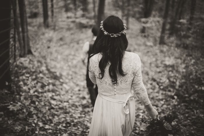 bride walking through the woods