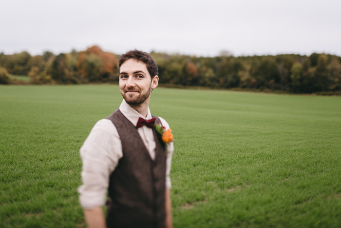 casual groom in vet and bow tie