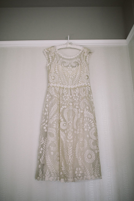 short wedding dress hanging up