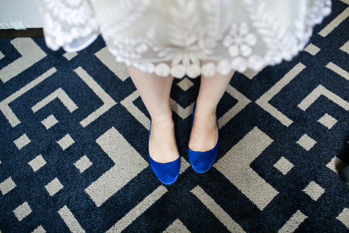 bride in blue suede shoes