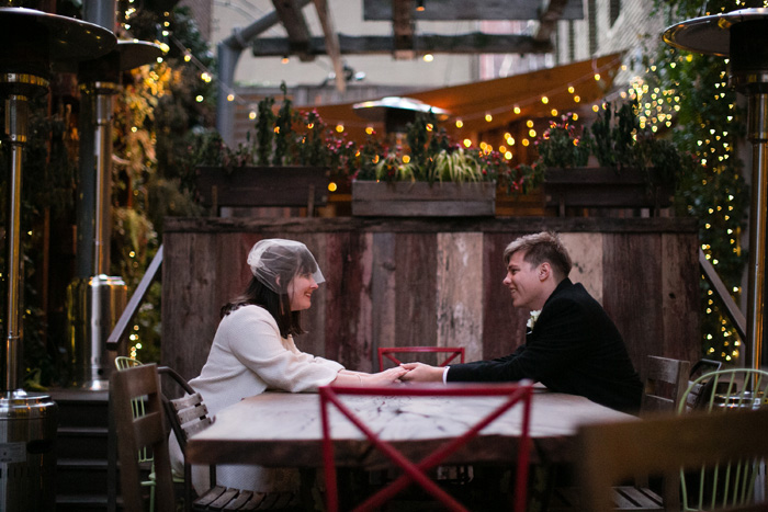 bride and groom sitting on patio
