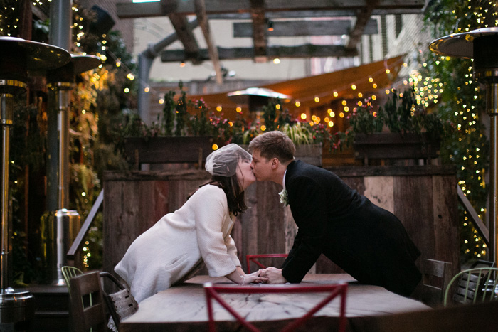 bride and groom kissing on patio