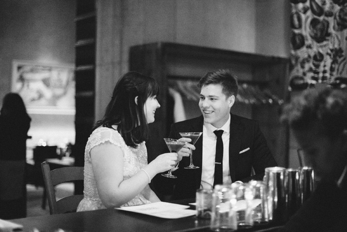 bride and groom having a drink at the bar