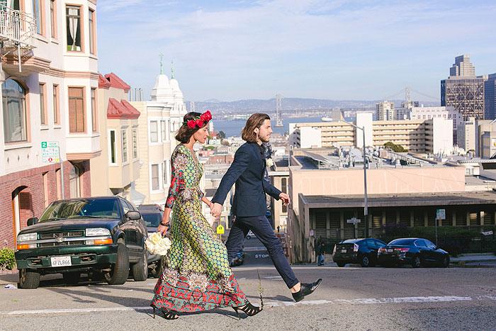 bride and groom crossing San Francisco street