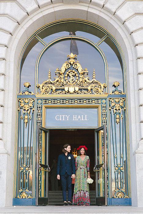 bride and groom in city hall doorway
