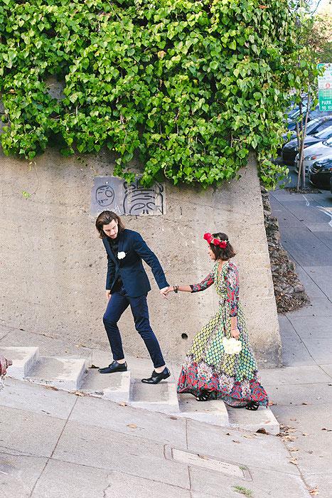 bride and groom walking up San Francisco street