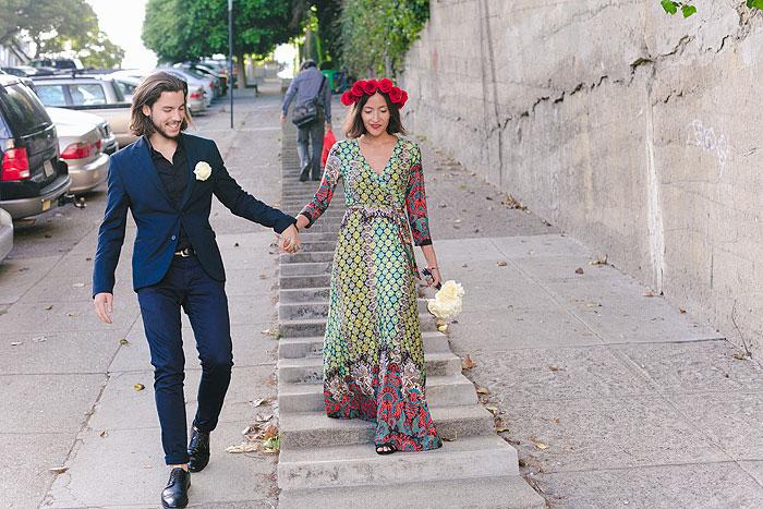 bride and groom walking down San Francisco street