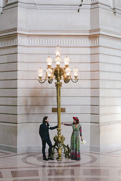 bride and groom inside San Francisco City Hall