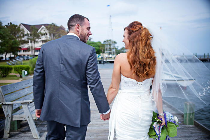 bride and groom walking down dock