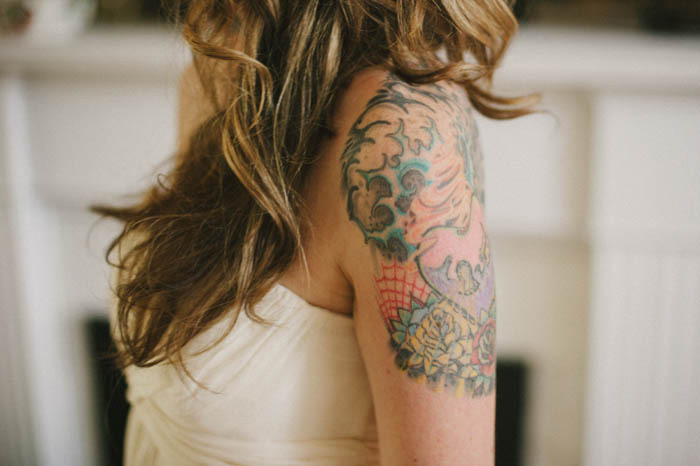 bride's arm tattoos