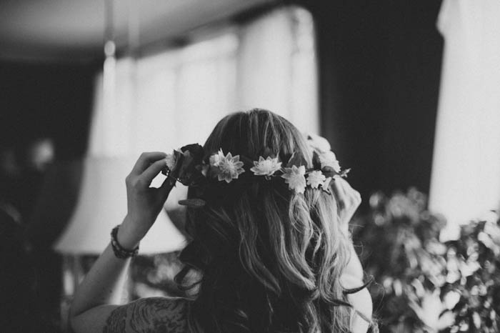 bride adjusting her flower crown