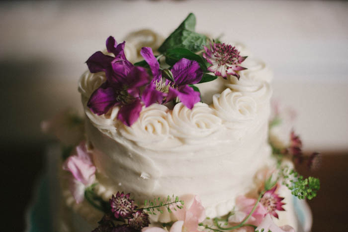 wedding cake topped with real flowers