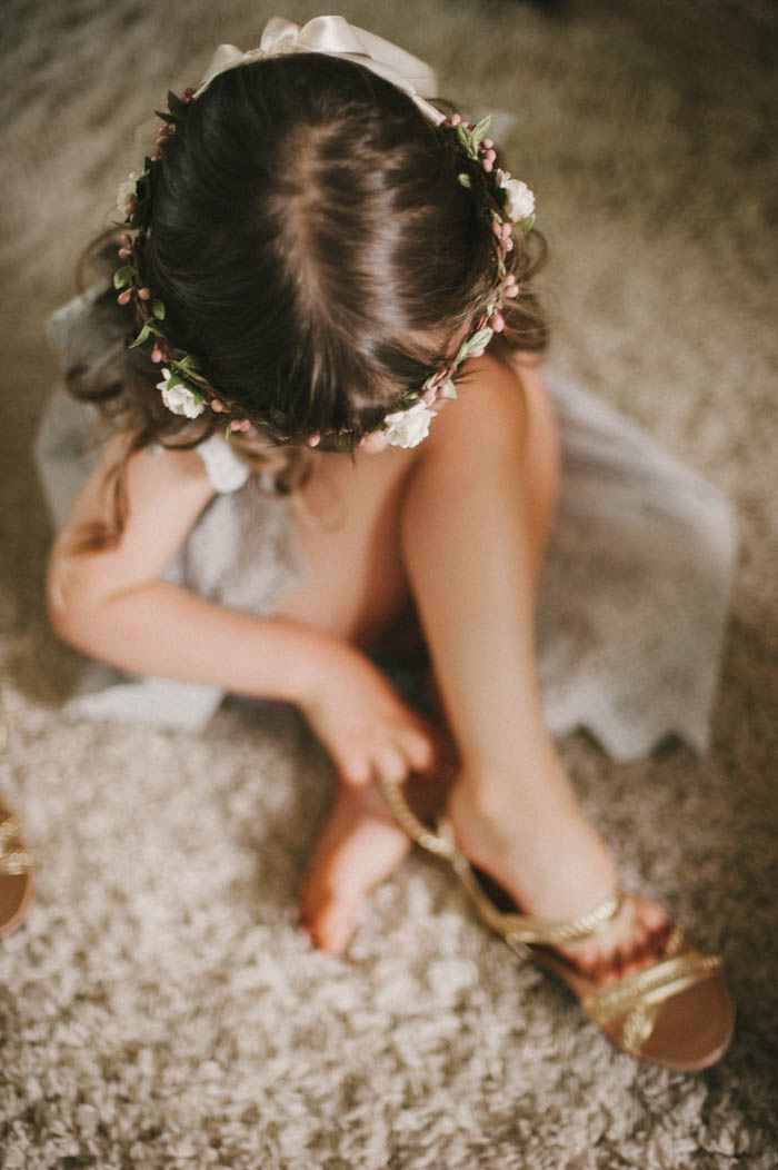flower girl putting on sandals