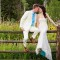 Mountain-Springs-Lodge-Plain-WA-bride-and-groom-on-fence thumbnail