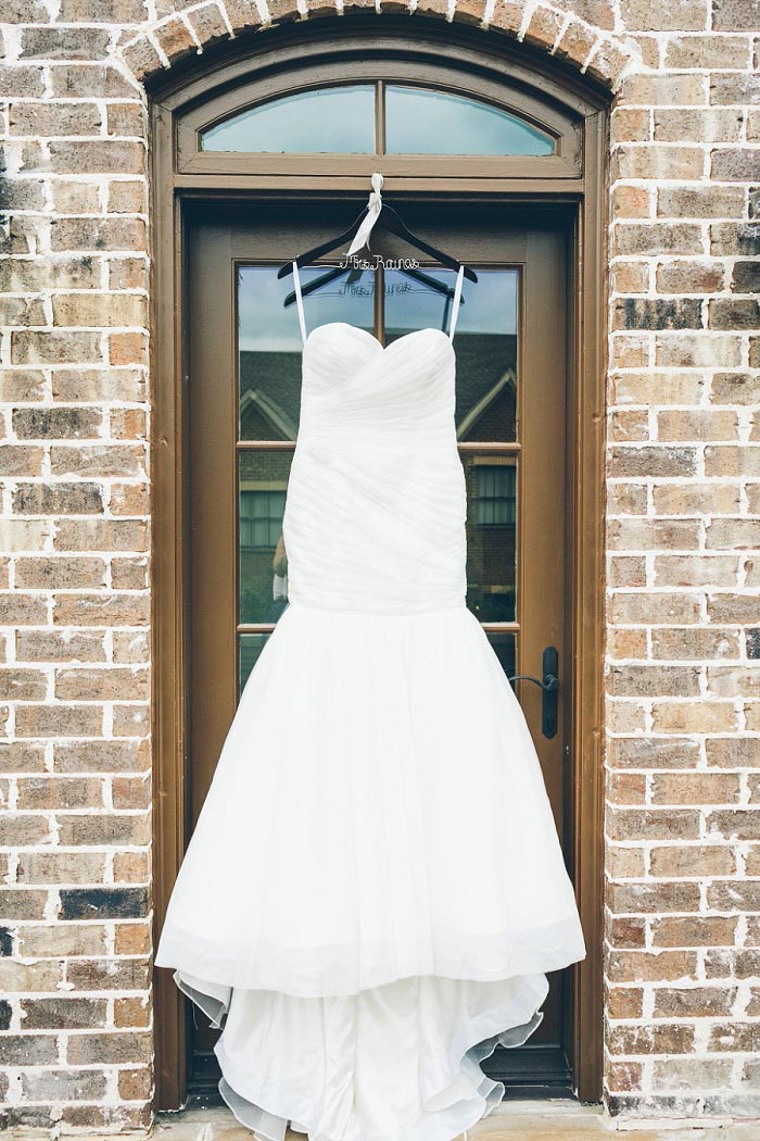 wedding dress hanging up outside