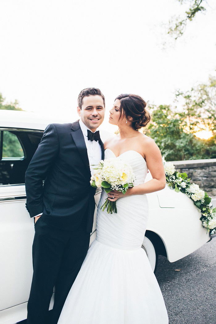 bride and groom in front of vintage car