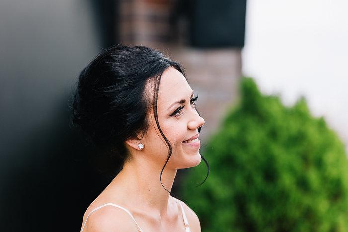 smiling bride during ceremony