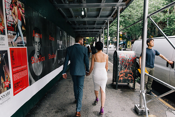 bride and groom walking in New York
