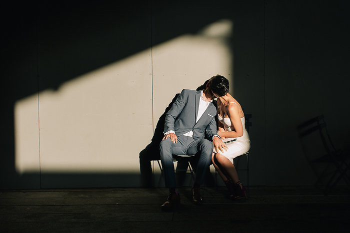 bride and groom kissing in the shadows
