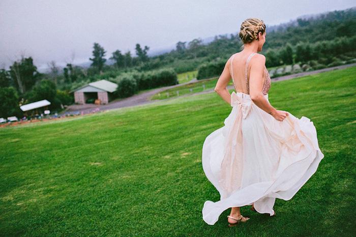 bride running on the grass