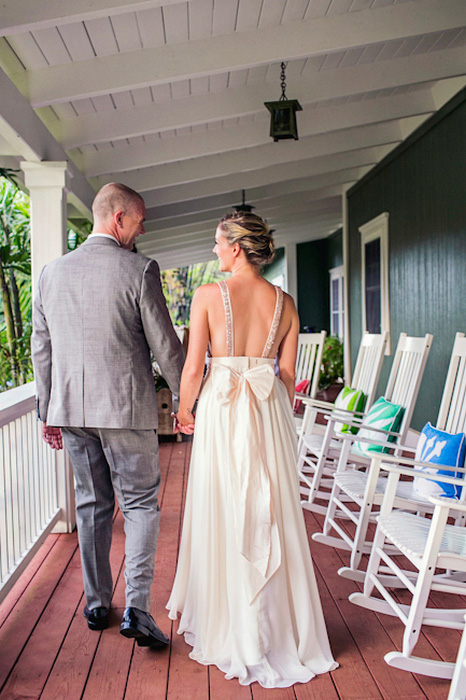 bride and groom walking on porch