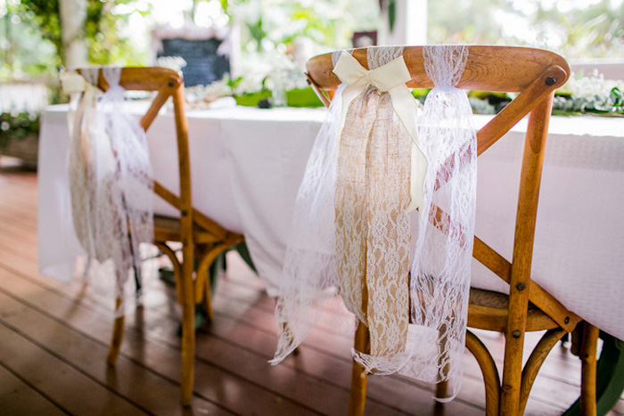 reception chairs decorated with tulle